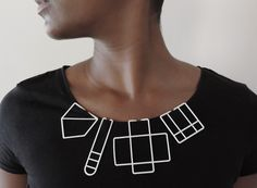 The LessIS collection of pendant necklaces comesfrom the idea to distill the concept of a necklace into its most basic form. The pendant found onnecklaces constitute the focal point of thepiece. By removing the chain, the collection re-imagines what a pendant canbe. Each work is constructed using through 3D printing and are composed of nylon.