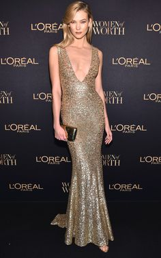 Karlie Kloss in a plunging gold sequin Michael Kors dress