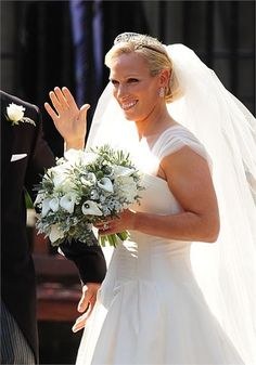 <p>During July of 2011, the Queen's granddaughter, Zara Phillips, married her rugby playing fiancé Mike Tindall. Zara Phillips wedding dress was designed by the Queen's own couturier and popular UK wedding dress designer Stewart Parvin. The elegant, sophisticated wedding gown worn by Zara Phillips featured a corseted bodice and a full skirt with organza straps that capped her shoulders. Zara Phillips wore her hair tied up with an elegant tiara and a long veil t...