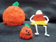 paper mache pumpkin and candy corn shelf sitters