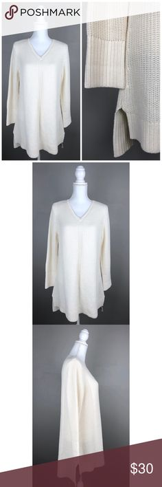 """NWOT Isaac Mizrahi Live Chunky Tunic Sweater Ivory NEW WITHOUT TAGS!  Isaac Mizrahi LIVE. Large. Ivory. Long sleeves, v-neck, side slits, hi-low style. Thick fabric. Picturesare part of the description.  60% Cotton, 40% Acrylic- Machinewash  {Measurements taken flat without stretching} Armpit to armpit approx. 21 - 21.5"""" Length approx. 30:"""" in front and34"""" in back  FAST SHIPPING!Usually ships same or next business day!! {Seller's note:C2} Isaac Mizrahi Sweaters"""