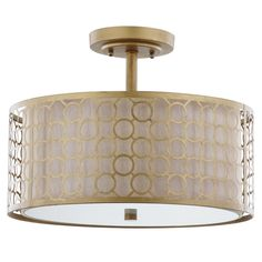 A distinctive marriage of a cream fabric shade with geometric-patterned laser cut steel in antique gold finish, the Giotta ceiling light showcases the glamorous drum shade-within-a-shade trend. Giotta is ideal for a transitional kitchen, bedroom, or hall.