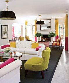 The white couches are great, like the matching hanging lamps that tie the spaces together. Gold/yellow with pink is nice, but I would do reds, greens and blues