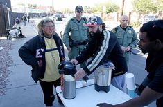 Las Vegas police step up ticketing of people feeding homeless Las Vegas police watch as Joey Lankowski, center, cleans up the area where he was distributing food on Foremaster Lane near Las Vegas Boulevard Wednesday, Nov. Lankowski was cited for pa . Police Watches, Las Vegas Review Journal, Good Samaritan, Z New, Step Up, Helping The Homeless, War, Wednesday, People