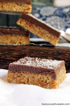 No Bake Chocolate Coconut Slice; Crunchy coconut biscuit base with a crispy milk chocolate top. Delicious, quick and easy.
