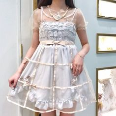 This is a cute, and unusual, hoop skirt. Baroque meets 1960's.