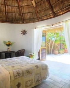 Local art, colorful tiles and a palapa roof lend Mexican flair to the casita bedroom. #Jetsetter