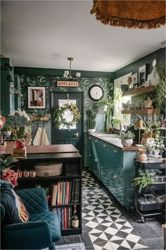 Every room of This London house is an explosion of envy-inducing color and pattern. | House Tours by Apartment Therapy #bedroom #kitchen #kitchenideas #colorfulkitchen #colorfuldecor #greenkitchen #kitchendecor #housetours #hometours Dark Green Walls, Beige Walls, Dark Walls, Black Slate Floor, Building A Cabin, Bauhaus Design, London House, Green Kitchen, Kitchen Layout