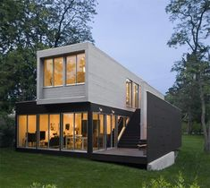 Looks a lot like a container home. The inside is amazing. Someday you will be my lake house.