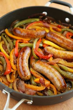Skillet Italian Sausage, Peppers and Onions - Easy comfort food for weeknights & game days! Serve over pasta, polenta, potatoes or on warm crusty rolls. Thecomfortofcooking.com