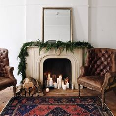 Yule style!! Noel Christmas! Winter solstice! Wonderful mix of modern Bohemian Chic and classic style! Leather wing chairs by a fireplace and a wonderful Oriental style area rug! But with clean fresh white walls and a simple garland across the mantel!