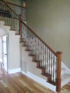 Check out https://www.sierrastairworks.com!  Stair options, wood railings, wood balusters, iron balusters.