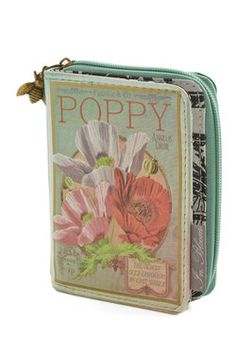 The Writing on the Wallet in Poppy. Plant a seed of whimsy with this unique mint-hued wallet by Disaster Designs. #green #modcloth