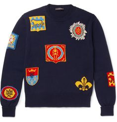 Inspired by British heritage and heraldry, <a href='http://www.mrporter.com/mens/Designers/Alexander_McQueen'>Alexander McQueen</a>'s navy sweater is knitted with colourful insignia intarsias. Some of the shields feature gothic skulls and skeletons - signatures of the London-based brand. This crew-neck piece has been crafted in Italy from soft cotton.