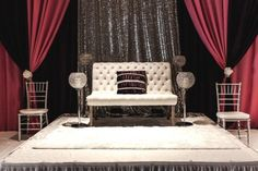 Head loveseat in front of a stunning back drop at a reccent Wedding Reception held in our Grand Ballroom with seating for 330 guests. Accenting the room with a color palette of fushcia, silver & purple hues!