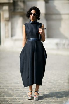 Yasmin Sewell - street style at Paris Fashion Week SS 2014.  Wearing a long black dress & fabulous silver sandals / flatforms