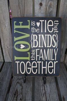 Primitive wood sign LOVE is the tie that BINDS this Family TOGETHER . . . Customize CoLoRs . . . personalized sign gift. $25.95, via Etsy.