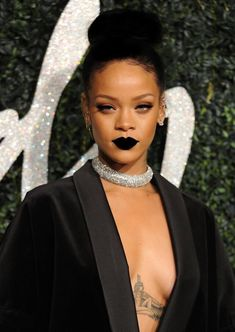 Rihanna wearing all black with rhinestone crystals encrusted choker. But my oh my, that black lipstick. Pulled off very well!     // Pinned on @benitathediva, DIY fashion inspiration.