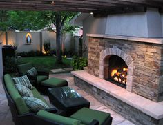Fire Places can be free standing or attached to the garage as in this landscape. It has a functioning chimney that is 14' high and adds to the grand scale of this fire feature and landscape. Landscape lighting can be seen throughout this outdoor living space and allows for enjoyment day and night.