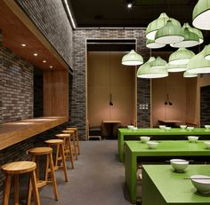 restaurant interior with lime green tables