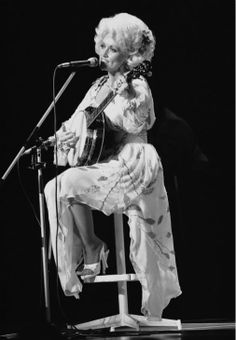 American singer Dolly Parton performs during her Tokyo concert on Monday, July 30, 1979. The popular vocalist, who won a Grammy award that year, sang 20 songs before a crowd of 1,600. (AP Photo)