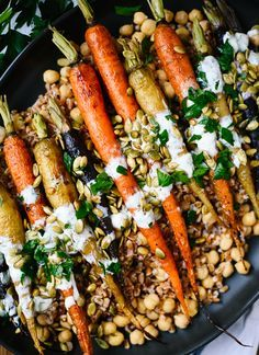 This roasted carrot recipe looks gourmet, but it's surprisingly easy to make! It would be a lovely option on your holiday table or a great weeknight dinner. With quinoa instead of faro.
