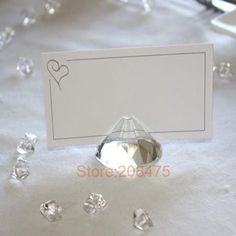 Your wedding reception will sparkle and shine when you accent your tables with this elegant crystal place card holder. Use them to direct guests to their seats, to hold table numbers, or as a chic way Wedding Reception On A Budget, Wedding Table Setup, Wedding Reception Outfit, Diy Wedding Dress, Wedding Pins, Wedding Trends, Wedding Advice, Wedding Ideas, Wedding Tree Guest Book