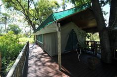 Overlooking the legendary Chiefs Island and bordering the Moremi Game Reserve, Gunn's Camp is one of the last few remaining luxury, vintage safari camps. Vintage Safari, Sight & Sound, Game Reserve, Tents, Wilderness, South Africa, Van, Camping, Island