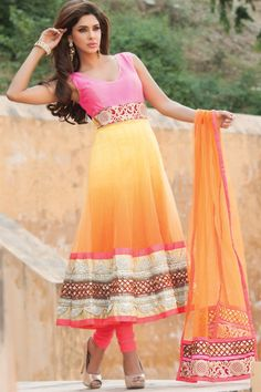 Dazzling yellow & orange net suit with cut work. Love the color combo.