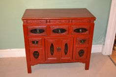 This is a stunning antique Chinese red lacquer chest circa 1900 in date. It has five useful drawers and a small cupboard. There are three small secretive little drawers across the top. The chest features a hand carved decorations throughout. There are black plaques on each drawer and door depicting hummingbirds and flowers. This is a lovely cabinet which is sure to add that oriental feel to your surroundings.
