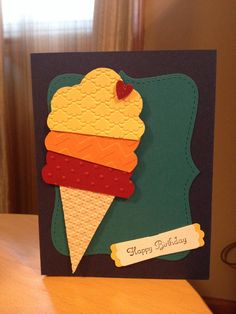 Ice cream cone birthday card  Paper used: Stampin' Up! Night of Navy (card) Island Indigo (center) Cherry Cobbler (ice cream scoop and heart) Pumpkin Pie (ice cream) & Daffodil Delight (ice cream and tag shadow)  Templates: Bigz Top Note (center). Self made template and free cut the cone and each scoop (cupcake topper would make a great scoop)  Textured impressions by Big Shot:  Ice Cream - Perfect Polka Dots, Embossing Folder Chevron & Embossing Folder Fancy Fan.  Cone - Square Lattice