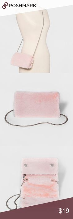 Fur Clutch New with removable Chain. Super trendy and soft pink fur. Great for a night out! Bags Clutches & Wristlets