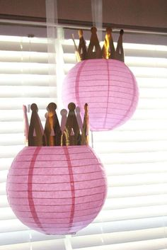 Pink crown topped paper lanterns at a Sofia the First birthday party! See more party ideas at CatchMyParty.com!