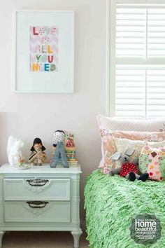 This nine-year-old's room is sweet and sophisticated, with bedlinen from Lazybones and a squirrel lamp from Have You Met Miss Jones atop vintage drawers that were restored with a lick of paint.