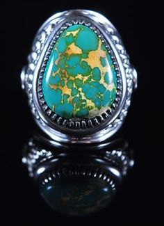Handmade ring, with natural Gem Grade Royston Turquoise, by Navajo artist Derrick Gordon.