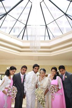 Dileesha and Manula with the retinue, posing for bridal party photographs at the Cinnamon Grand Colombo lobby.