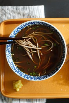In Japan, where it gets plenty hot in the summer, cold soba noodles, served with a dipping sauce, are a common snack or light meal. Soba are brown noodles, made from wheat and buckwheat, and the sauce is based on dashi, the omnipresent Japanese stock. (Photo: Craig Lee for The New York Times )