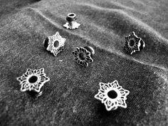 Lotus ear plugs in brass and silver by Forbidden Fruit,  https://www.facebook.com/forbiddenfruitjewelery/app_251458316228