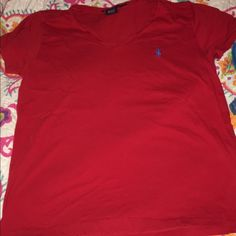 Ralph Lauren Polo This shirt is perfect for everyday wear. Only worn a couple of times. No holes or stains. Let me know if you have questions. Ralph Lauren Tops Tees - Short Sleeve