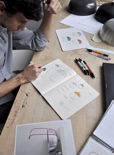 Tommaso Caldera encloses Tull Lamp in a wire cage | Interior Sign Design