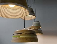 Michael Wolke Creates Sculptural Pendant Lamps From Strips of Old Cardboard.  im not patient or meticulous enough to do this, but someone could