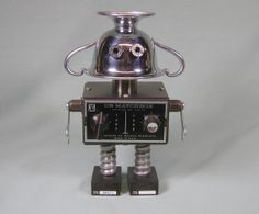 Etsy listing at https://www.etsy.com/listing/181669701/matchbox-found-object-robot-sculpture