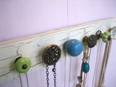 Another great jewelry organizer. Piece of wood and some cute door knobs