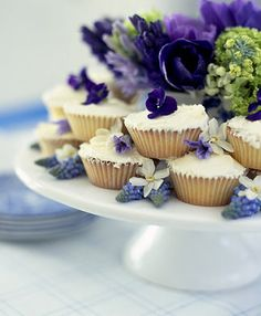 Pretty blue pansies top cupcakes....so pretty for your table at a shower or ladies tea