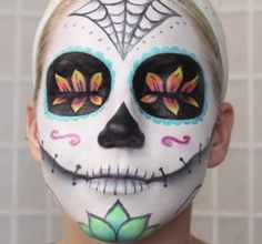 Typically associated with the Mexican Day of the Dead holiday, a sugar skull is an artistic and colorful way to amp up your Halloween makeup. #halloween #costume