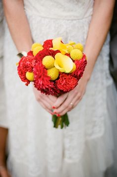 Loving this bouquet. This wedding had red, turquoise, and yellow as its colors!