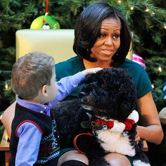Bo Obama, the first dog – and his Mom! – bring holiday cheer to 5-year-old AJ Murray and other patients at the Children's National Medical Center in Washington, D.C.,