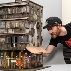 Artist Joshua Smith is a miniaturist who specializes in creating 1:20 scale models of urban environments, complete with rust, grime, and graffiti.