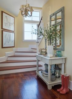 Beach house nautical foyer with maps as decor + weathered table