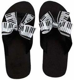 PIANO KEYS FLIP FLOPS Kids - Saucy grosgrain keyboard ribbons jazz up our black rubber flip flops.  Available in Kids sizes: 6, 8, 10